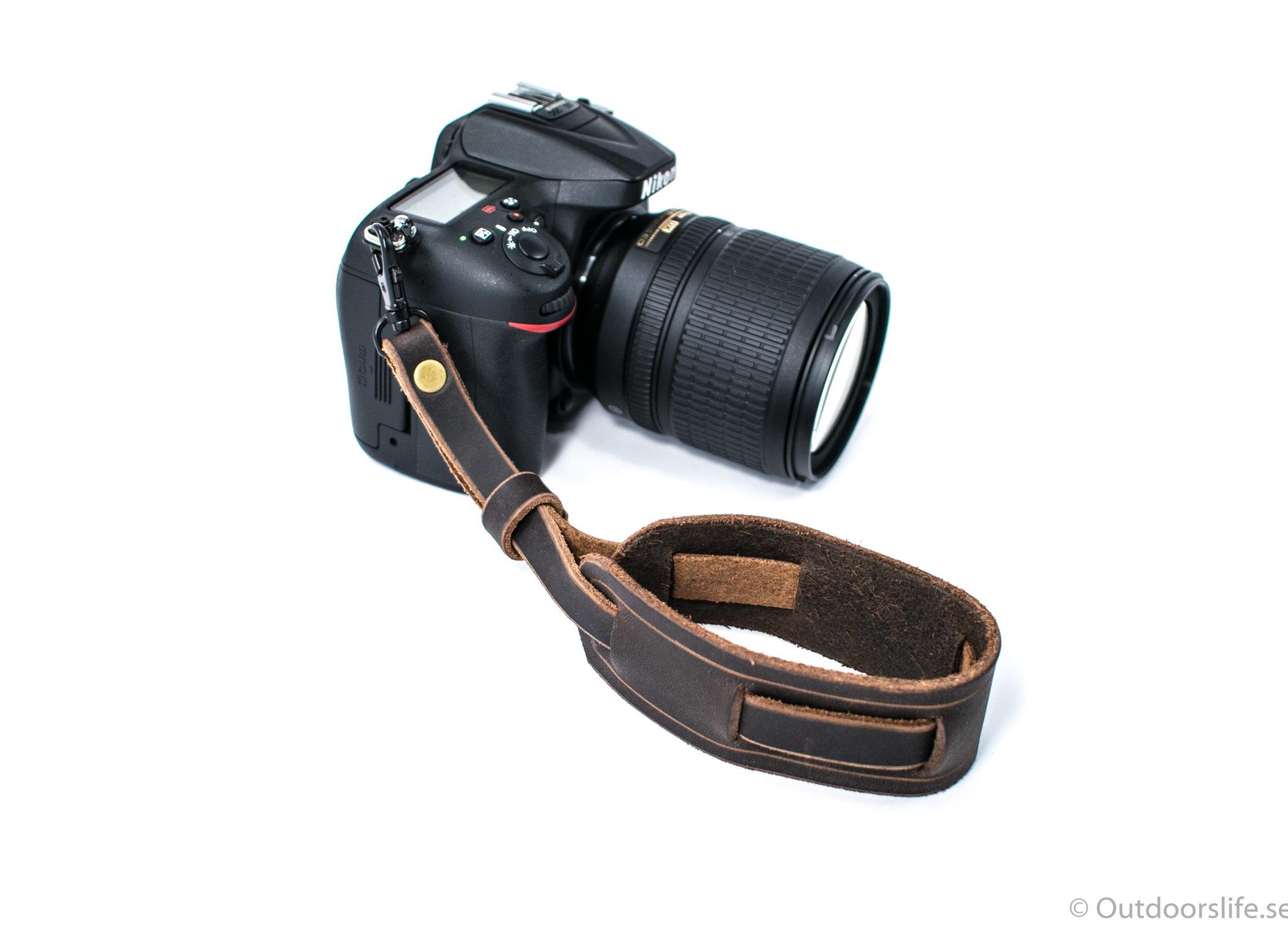 kamerarem brun läder